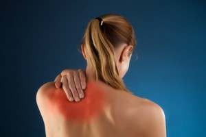Alexander Technique helps back pain - picture of woman rubbing back