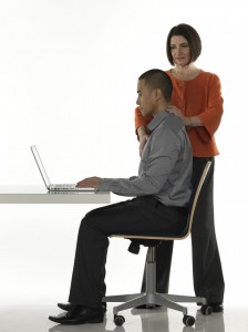 Tanya Shoop giving specialist postural guidance to someone at laptop